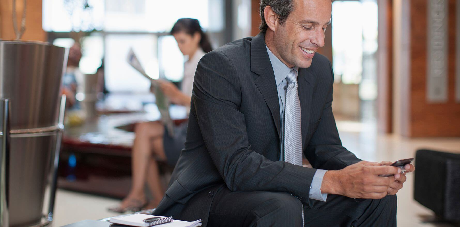 Man smiling at phone about Voice & Data Services For Business available